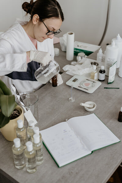A woman testing Palmitoylethanolamide in the Lab